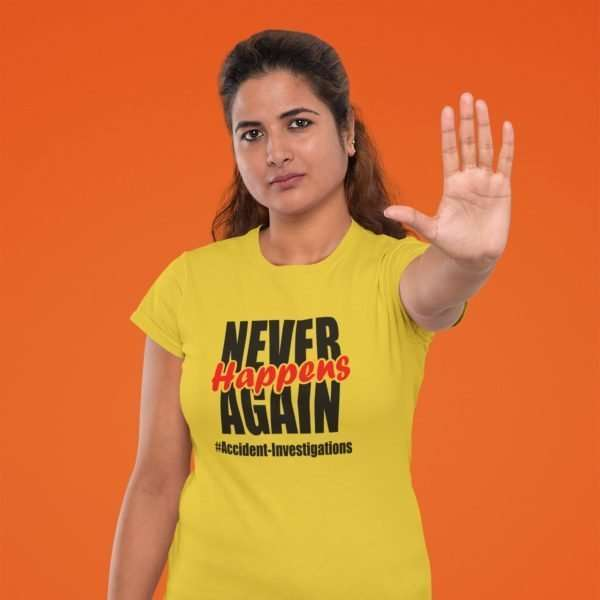 Woman Wearing a Orange tshirt that says Never Happens Again #accident Investigations