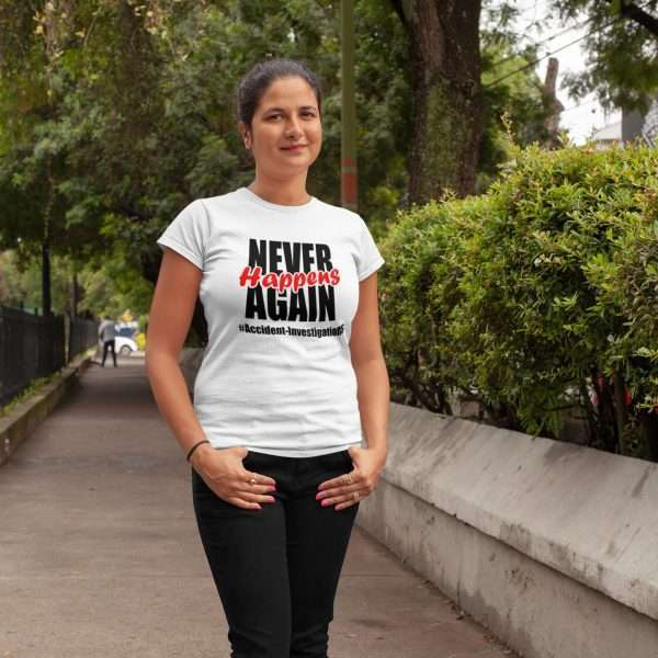 Woman Wearing a white tshirt that says Never Happens Again #accident Investigations