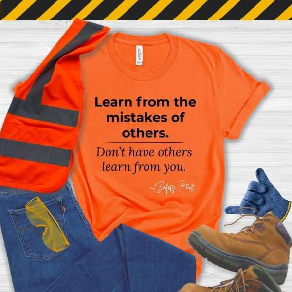 Orange Safety Manager Tshirt with a Safety Slogan that says Learn From the Mistakes of Others Not from you