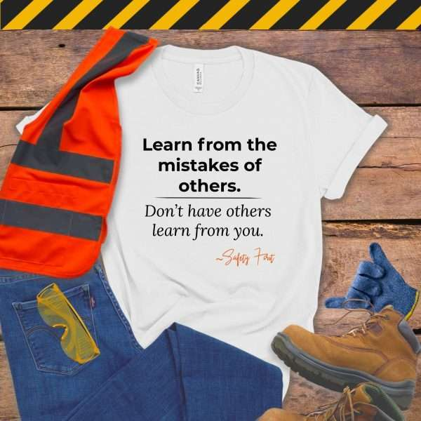 White Safety Manager Tshirt with a Safety Slogan that says Learn From the Mistakes of Others Not from you
