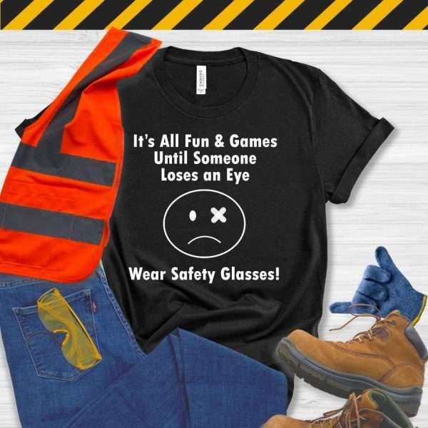 Black tshirt that says it's all fun & games until someone loses an eye wear safety glasses