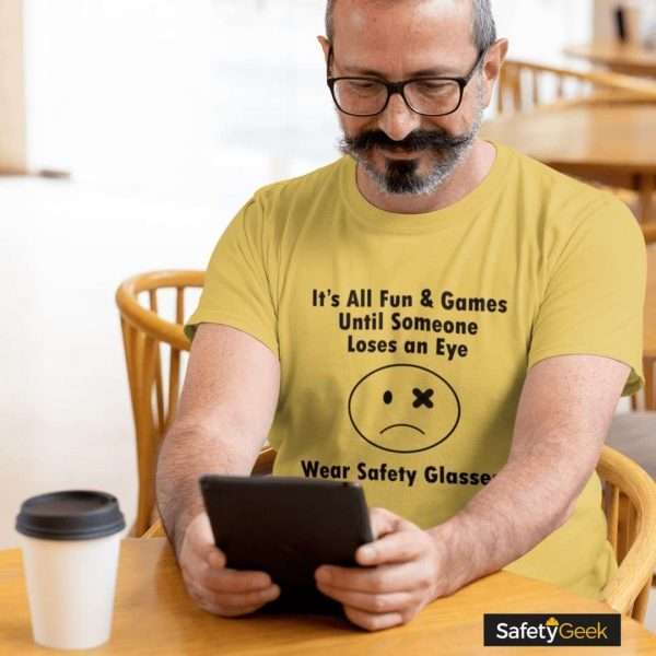 Safety Manager in coffee shop on tablet wearing a funny safety tshirt
