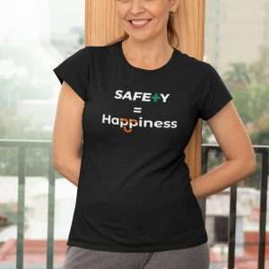 Woman wearing a black tshirt with workplace safety slogan on it