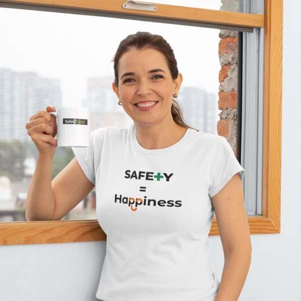 Woman holding a cup of coffee wearing a white tshirt with a safety slogan