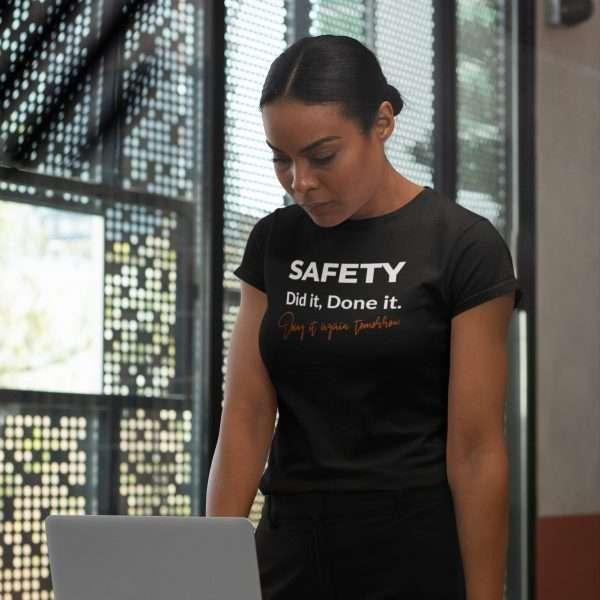 women at a computer wearing a safety slogan tshirt