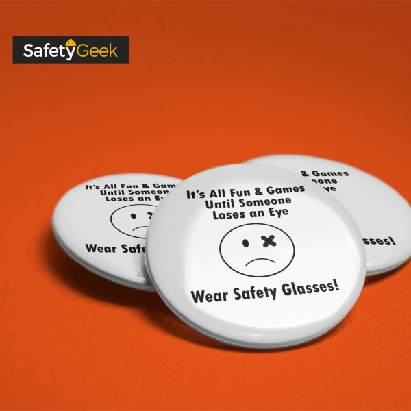 pin with a sad face and an injured eye promoting wearing PPE